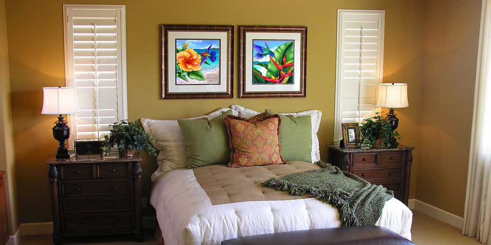 Bedroom with two framed prints