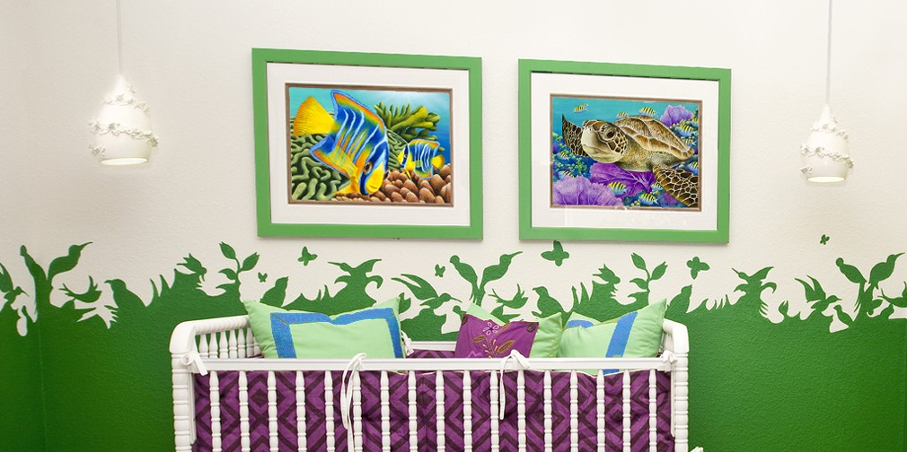 Baby's nursery with two framed prints by Carolyn Steele