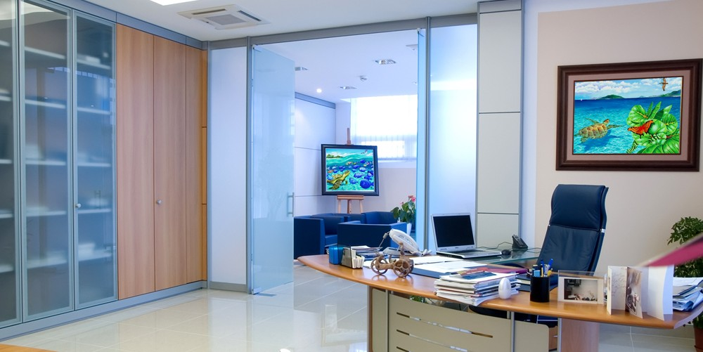 Office spaces with framed art by Carolyn Steele