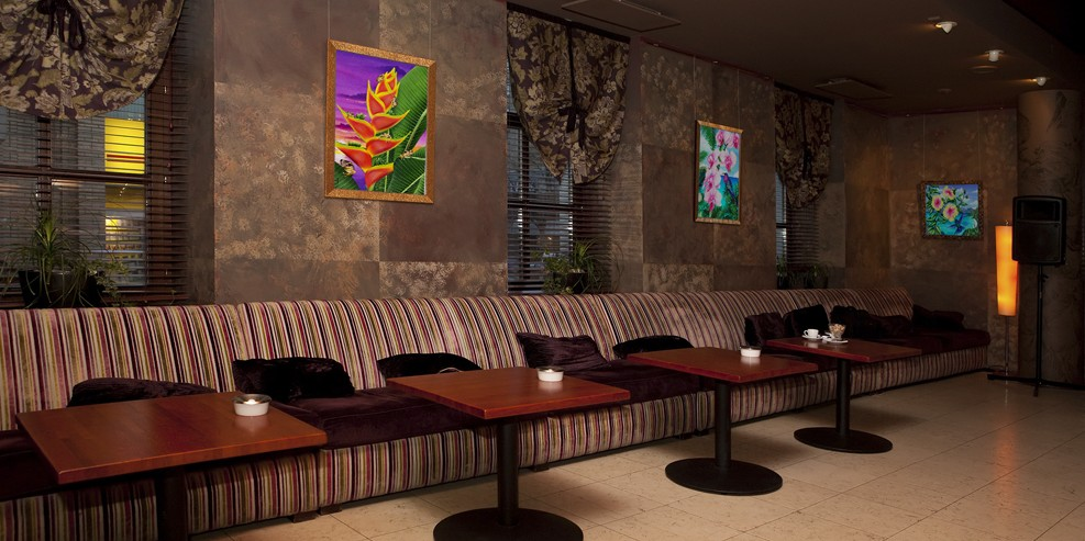Restaurant interior with framed art by Carolyn Steele