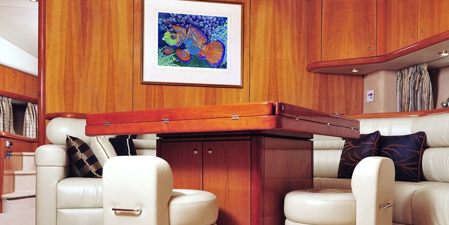 Luxury yacht interior with framed art by Carolyn Steele